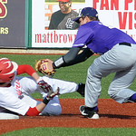 Avon's Brian Baker tags out Elyria's Ben Haywood on a steal attempt in the third inning at All Pro Freight Stadium. STEVE MANHEIM/CHRONICLE
