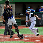Elyria Catholic's Sean Darmafall prepares to touch home plate before Independence catcher Brycen Wise can catch the ball during the second inning Wednesday. STEVE MANHEIM/CHRONICLE