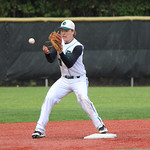 Elyria Catholic second baseman Christian Stanziano gets the out at second. CHRISTY LEGEZA/CHRONICLE