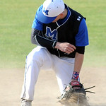 A ground ball gets past Midview's Caleb Dull in the fourth inning. STEVE MANHEIM/CHRONICLE
