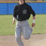 Elyria Catholic's Lukas Redmond runs for third base in the fourth inning. STEVE MANHEIM/CHRONICLE