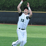 Elyria Catholic first baseman Joey Begany catches a pop fly against Wellington. KRISTIN BAUER/CHRONICLE