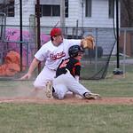 Elyria third baseman Kevin Cloen picks off Zach Gillard on a throw from catcher Broadie Stewart. CHRISTY LEGEZA/CHRONICLE