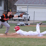 Elyria's Zack Rosenkoetter gets a triple in the bottom of the sixth against North Olmsted. CHRISTY LEGEZA/CHRONICLE