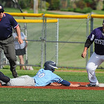 Keystone first baseman Korey Horne catches a throw as Benedictine's Connor Hopkins slides back to the base.  KRISTIN BAUER   CHRONICLE