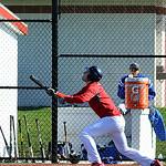 Lutheran West's Joe Peters hits an RBI sacrifice bunt.  STEVE MANHEIM/CHRONICLE