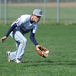 Lorain's Brandon Bartlome fields a ground ball hit into left field. KRISTIN BAUER | CHRONICLE