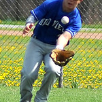 Midview's Zac Wilson fields a ground ball in the outfield.  KRISTIN BAUER | CHRONICLE