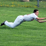 Elyria right fielder Zack Rosenkoetter dives for a fly ball.  KRISTIN BAUER | CHRONICLE