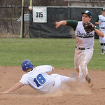 Westlake's Justin Runevitch attempts the double play on Midview's Tyler Lienerth. STEVE MANHEIM/CHRONICLE