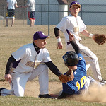Vermilion's #29 Nick Dlugosz swings the glove around to try to tag Clearview's #10 Jack Bennett sliding into second with #17 Caleb Waller backing him up. Jack was called out.