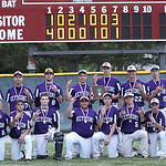 The Keystone team poses and each gestures three for their third Divsion III district win in Parma. photo by Ray Riedel