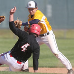 Elyria's #4 Brodie Stewart slides into second as North Ridgeville's #9 Logan Armaro goes for the tag. While the umpire called him safe, North Ridgeville insisted they made the tag.