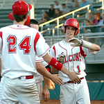 Firelands' #1 Kevin Rollins gets congrats after hitting a sacrifice fly to bring a runner home.