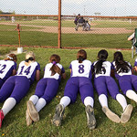 Keystone's varsity softball team watches the seventh inning of the Varistiy baseball game against Buckeye. Photo by Aaron Josefczyk