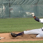Lorain's #32 Nic Billingsley slides safely into second as Cleveland Heights' #8 Zander Perelman waits for the ball.