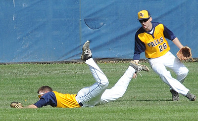 Olmsted Falls outfielder Matt Archual makes a diving catch next to Mike Sheneman (26) on May 3.  STEVE MANHEIM/CHRONICLE