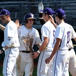 Vermilion Caleb Waller , second left, with teammates after scoring in second inn. May 20.  Steve Manheim