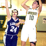 Amherst's #10 Brianna Shagovac shoots past Lorain's #24 Onyx Lopez