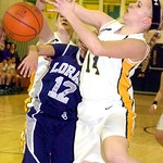 Amherst's #14 Mallory Sliman fights Lorain's #12 Angelique Flores for the ball.