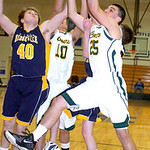 Amherst's #25 Kyle Kelley grabs the rebound before North Ridgeville's #40 Jacob Ruoff.