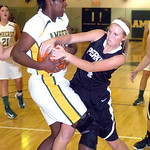 Amherst's #34 Brooke Wallace hangs on to the ball as Perkins' #4 Darcy DAniel tries to take it away.