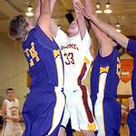 Avon Lake's #33 Seth Muck tries to shoot past Avon's #24 A.J. Kistler and #22 Matt Lawrence
