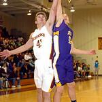 Avon Lake's #42 Brad Hamilton and Avon's #10 Jack Poyle fight for the rebound.
