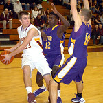 Avon Lake's #23 Jimmy Hessel works to pass the ball past Avon's #13 Cordell Winters and #10 Jack Pyle.