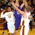 Avon's #10 Jack Poyle tries to shoot past Avon Lake's #22 Christian Jones and #42 Brad Hamilton