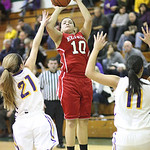 Shayla Middlebrooks of Elyria shoots over Avon's Sarah Sprecher, left, and Sierra Davidson. RAY RIEDEL/CHRONICLE
