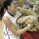 Avon's Sierra Davidson and Elyria's Sierra White struggle for possession of the ball. RAY RIEDEL/CHRONICLE