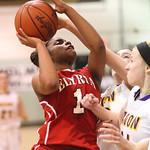 Elyria's Sybil Roseboro shoots through defense by Avon's  Mackenzie Meckes and Rachael Poling to tie the game at 47. RAY RIEDEL/CHRONICLE
