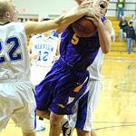 Avon RJ Kauffman drives between Midview 22 Patrick Geyser and Patrick Linn, rear, on Feb. 15.  Steve Manheim