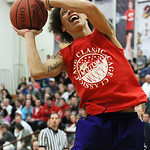 ANNA NORRIS/CHRONICLE Clearview's Gerrell Williams muscles up a basket for the East team during the Lorain County Boys Legeza Cage Classic all-star game at Oberlin College Sunday night.