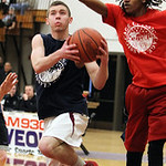 ANNA NORRIS/CHRONICLE Wellington's Dylan Kidd goes up for the layup against Oberlin's Charles Lewis in the first half of the Lorain County Boys Legeza Cage Classic all-star game at Oberlin C …