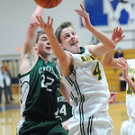 Amherst's Danny Fortney grabs a rebound away from Cloverleaf's Andrew Jarrett in fourth quarter of the consolation game at the Bob DiFranco Holiday Tournament at Midview High School Saturday …