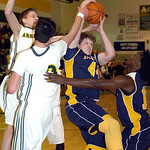 North Ridgeville's Nathan Colbert fights Amherst's Danny Fortney and Matt Kneisel for the ball. LINDA MURPHY/CHRONICLE
