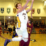 Avon's Dan Durrin drives around Avon Lake's Seth Muck. LINDA MURPHY/CHRONICLE