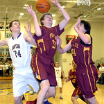 Avon's Chris Maxwell, left, and Avon Lake's Seth Muck, center, and Matt Molina battle for a rebound. LINDA MURPHY/CHRONICLE
