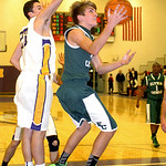 Elyria Catholic's Conner Riddell tries to shoot past Avon's Jordan Lawrence. LINDA MURPHY/CHRONICLE