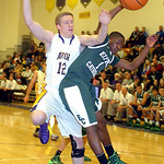 Elyria Catholic's DJ Graham fight Avon's Austin Proudfit for the ball.  LINDA MURPHY/CHRONICLE