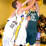 Avon's Johnny Peganoff and Austin Proudfit fight Elyria Catholic's James Tirbaso for the ball.  LINDA MURPHY/CHRONICLE