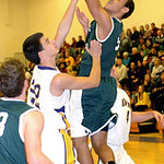 Elyria Catholic's Ceeven Shelton shoots past Avon's Brad Sprecher.  LINDA MURPHY/CHRONICLE