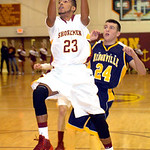 Avon Lake's Christian Jones passes North Ridgeville's Jordan Montgomery on the way to the basket. LINDA MURPHY/CHRONICLE