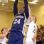 Lorain's Rashod Berry shoots past Avon's Johnny Peganoff. LINDA MURPHY/CHRONICLE
