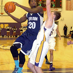 Lorain's Gerald Howard goes up for a basket past Avon's Chris Maxwell. LINDA MURPHY/CHRONICLE