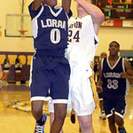 Lorain's Sherman Saunders tries to shoot past Avon's Chris Maxwell. LINDA MURPHY/CHRONICLE