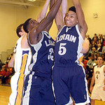 Lorain and Avon players fight for the rebound. LINDA MURPHY/CHRONICLE