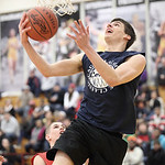 Wes Davic of Midview goes for a layup in the Lorain County Boys All Stars Legeza Classic at Oberlin College. photo by Ray Riedel